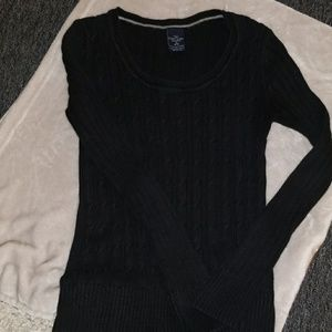 Women's black cable knit sweater